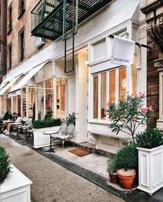 Looks like a cozy spot to rest your legs for a quick cup of espresso when visiting NYC. Visiting Nyc, Cafe Bar, Architecture Photo, We Heart It, Scenery, Street View, Vacation, Mansions, House Styles