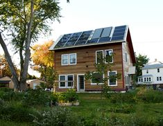 solar-pv-on-white-metal-roof-with-solar-hot-water