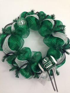 Saskatchewan Roughrider deco mesh wreath by SuesSeasonalWreaths Saskatchewan Roughriders, Rough Riders, Deco Mesh Wreaths, Wreath Ideas, Merry And Bright, Ladybug, Christmas Wreaths, Projects To Try, Pride