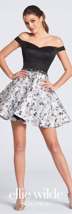 Off-the-shoulder satin and jacquard short A-line skater dress with sweetheart satin bodice, hand-beaded waistband, and gathered jacquard skirt.