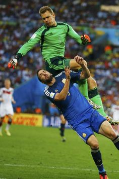 Argentina's Gonzalo Higuain fouls Germany's goalkeeper Manuel Neuer during their 2014 World Cup final at the Maracana stadium in Rio de Janeiro July 13, 2014.