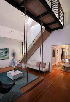 Saving the soul of a hippie Victorian house in the Haight. Mork Ulnes, Clayton Street, Swing in Living Room | Remodelista