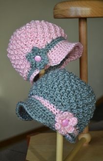 Andrea Nubby Cap for twins with crochet flower attached.