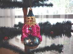 Patriotic antique ornament clown on ball $175