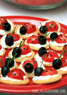 Lady bugs. Cherry tomatoes sliced atop a Ritz crackers pread with cream cheese. Whole Olive. Use scallion for antenna. Pipe spots with frosting