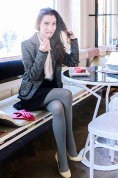 Fashion blogger Veronika Lipar of Brunette From Wall Street sharing how to wear the fishnet tights this winter