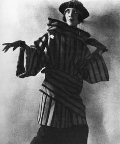 "Lilya Brik modelling an avant-garde outfit by Lamanova. Pablo Neruda called her the ""muse of the Russian avant-garde"". Her name was frequently abbreviated by her contemporaries as ""Л."" which are the first letters of a Russian word «любовь 20s Fashion, Art Deco Fashion, Retro Fashion, Aragon, What Is A Portrait, Avantgarde, Hammer And Sickle, Russian Avant Garde, Vintage Fashion Photography"