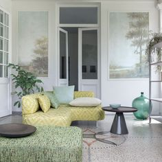 pastels so pretty and love the wall murals in this living space