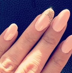 Pink/Light Salmon nails with a single gold tip