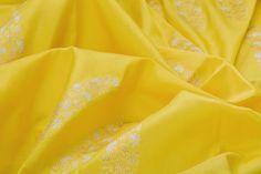 Yellow banarasi silk with white moghul motifs