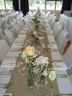 The burlap is interesting but looks cheap on a sparsely decorated table and overly bright-white table and chair linens.