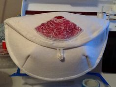 A new travel bag for make up. The lining is of a fuchsia pink. I loved beading the roses.  It will be a gift.