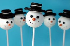 these cakepops are pretty darn cute. The noses are orange sunflower seeds. The eyes are black confetti sprinkles to look like coal. The mouths are drawn on with a black edible ink pen and the hats are regular and mini size Oreos.  [how-to included] I will make this with a friend from my:)