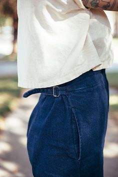 delicate detail photo of high waisted pants and a cropped shirt