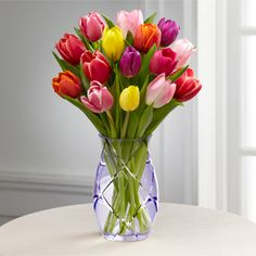 Designer keepsake vase and colorful tulips to show your appreciation for your assistant's hard work all year.