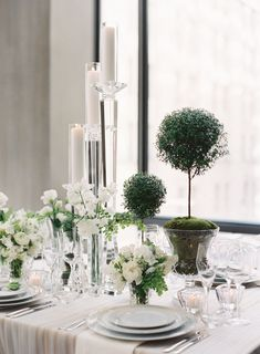 Well Groomed- ELLEDecor.com Simple and Elegant Greens and White Rose's Wedding Centerpiece table seating