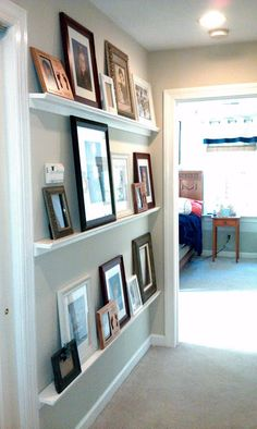 DIY: Gallery Art Wall for hallway wall between bath and kitchen. Like the idea, but couldn't have that low with children in house