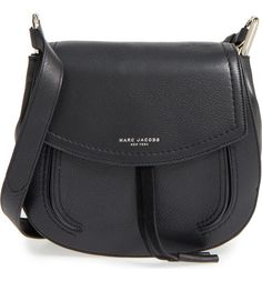 A curvy shoulder bag is done up in supple textured leather and highlighting by signature metallic branding at the flap.