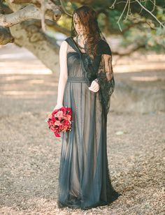 Greek mythology-inspired wedding -black and nude gown, black lace veil, red calla lilies, pomegranates. Love.