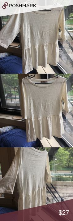 LOFT peplum top! NWOT new without tags! LOFT online exclusive super soft peplum sweater blouse. looks wrinkled in pics because i just moved and it was in a box but it can be steamed. creamy white color LOFT Tops Blouses