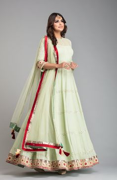 Mukaish Pista green anarkali with contrast of red clubbed with a chudidar and mukaish net dupatta. Kurti Designs Party Wear, Lehenga Designs, Kurta Designs, Blouse Designs, Indian Gowns, Indian Attire, Indian Outfits, Indian Wear, Indian Designer Outfits