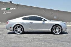 """2006 Bentley Continental GT we used a set of 22"""" AC Forged Split 5 wheels with a brushed face, and chrome lip. Wheel and tire set up is 22x9 & 22x11 wrapped with 265-30-22 & 295-25-22 Pirelli Tires *Custom engraved Bentley Logo** star spoke"""