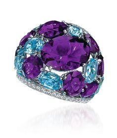 CELLINI Jewelers- Amethyst and Blue Topaz Ring - Oval-shaped Amethysts and blue Topaz are bordered by rows of round brilliant Diamonds, set in 18-karat white Gold. Diamond weight: approximately 1.27 carats total. Amethyst weight: approximately 13.23 carats total. Blue topaz weight: approximately 2.82 carats total. ☆$7,200.00☆