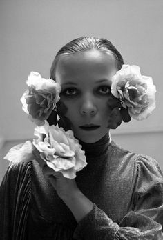 Penelope Tree photographed by Cecil Beaton, Oct. 1972, 1/14 Aeppli figures, Vogue. Hair roses now seen at Dolce & Gabbana