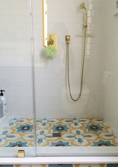 The qualities that make Granada Tile's cement tiles perfect for a hardworking coffee shop floor tile or restaurant tile floor — in addition to their . **love the funky tile on the flooring with the simple white subway tile on the wall, super fun** Bathroom Inspiration, Cement Tiles Bathroom, Cement Tile, Small Bathroom, Bathroom Floor Tiles, Bathroom Design, Bathroom Flooring, Tile Bathroom, Shower Floor