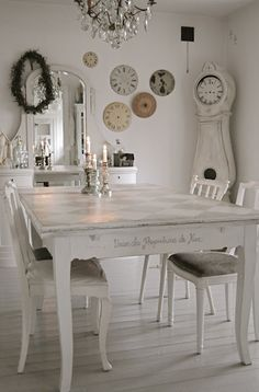 Whitewashed table with French script on edge. Whitewashed floor.