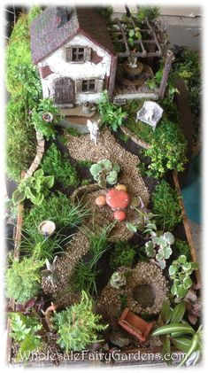 Fairy Garden in the wheelbarrow with a stairway lading to a fairy house in the tree. Description from pinterest.com. I searched for this on bing.com/images