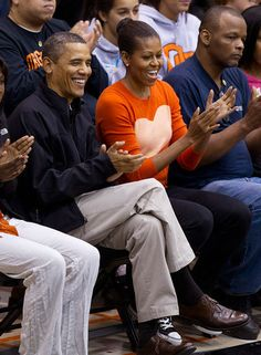 President Barack Obama and the First Lady Michelle Obama enjoy college basketball at Towson University in Towson, Maryland. AT MY SCHOOL