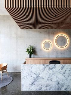 Wouldn't mind working a Saturday shift here. Great L lobby and reception design. Love the material combination of concrete, marble, and wood. Interior Design Minimalist, Australian Interior Design, Interior Design Awards, Commercial Interior Design, Contemporary Interior Design, Commercial Interiors, Lobby Interior, Modern Design, Marble Interior