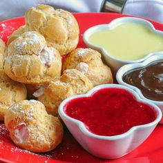 Raspberry Cream Profiteroles with 3 Dipping Sauces, a raspberry coulis plus chocolate & white chocolate panache dips. A perfect romantic dessert to share.