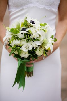 Green & white lady slipper orchids, anemones, freesia, ranunculus, and spray roses, hydrangeas and berries. Hana Floral Design, Mystic, CT