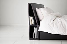Storage behind headboard - could easily be integrated into the bed unit.