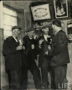 Rare photograph of Irish workers stopping off for a pint. The men spent the little money they had in the pub while women and children went hungry.