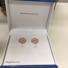 Beautiful 18k rose gold diamond accent earrings These are sooo adorable and match the necklace I have for sale in my closet.  These are 18k gold over brass.  The color is gorgeous and the cute flowers make these classy and unique.  There is a real diamond in each (tiny).  Comes in box with tags.  Never worn. Jewelry Earrings