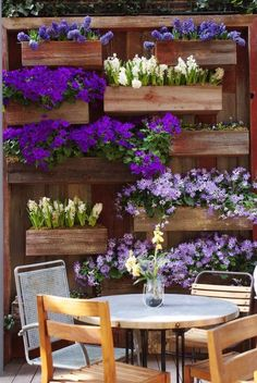 Outdoor setting with purple floral living wall