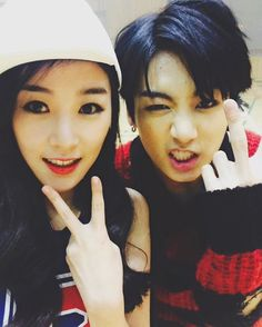 Jungkook with his cousin (yes she was in the war of hormone mv.......) < man the jeon family must be one good looking family