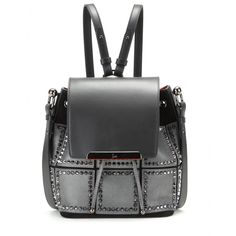 Christian Louboutin - Luckyl suede and leather shoulder bag - Christian Louboutin updates the coveted bucket bag in a stylish, studded design. The suede and leather piece comes in a classic black with metallic silver panels and a luxe red lining to keep in line with the house's signature aesthetic. Pair the piece with a tonal ensemble for a tough-luxe touch. seen @ www.mytheresa.com