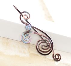 Shawl pin or scarf pin in snail shape with light blue mystic quartz bead and a pin stick