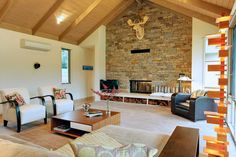 Fasham Melbourne builders and a double sided Cheminees Philippe fireplace in the Yarra Valley. Love the stonework and wood storage.