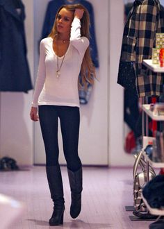 white long sleeve v-neck/dark jeans/dark tall boots/ long necklace