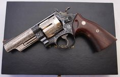 Custom engraving pinto finish on S&W Model 29 .44 magnum 6-shot DA/SA revolver https://en.wikipedia.org/wiki/Smith_%26_Wesson_Model_29 -------------The early model marked 29 shipped to J.S. Oshman Co. in Houston, TX in October of 1959. It was factory engraved by Russ Smith and shipped in the configuration shown below: