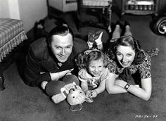 "Jack and Mary Benny with their daughter, Joan. Barbara was close to both Mary and Jack Benny. She thought Jack the dearest man in the world. Jack was equally crazy about Barbara. ""For my money,"" he said, ""along with all the nobler virtues, such as loyalty and integrity, Barbara has the greatest sense of humor in Hollywood."" From Victoria Wilson's A LIFE OF BARBARA STANWYCK Steel-True 1907-1940."
