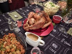An American Thanksgiving: roasted turkey, cranberry sauce, gravy, stuffing and mashed potatoes