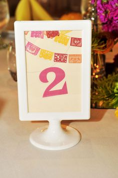 Papel Picado inspired table numbers Photograph by ZADesignz http://www.storyboardwedding.com/a-colorful-explosion-of-mexican-themed-elements-in-a-swoon-worthy-wedding-fiesta/