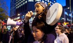 Guardian coverage, Oct 21, 2013  A girl plays the drums as she sings a traditional First Nations song during an anti shale gas demonstration in Montreal in support of the Mi...