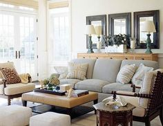 I love the light gray/blue and cream! Those mirrors and lamps would be a great addition to our living room.